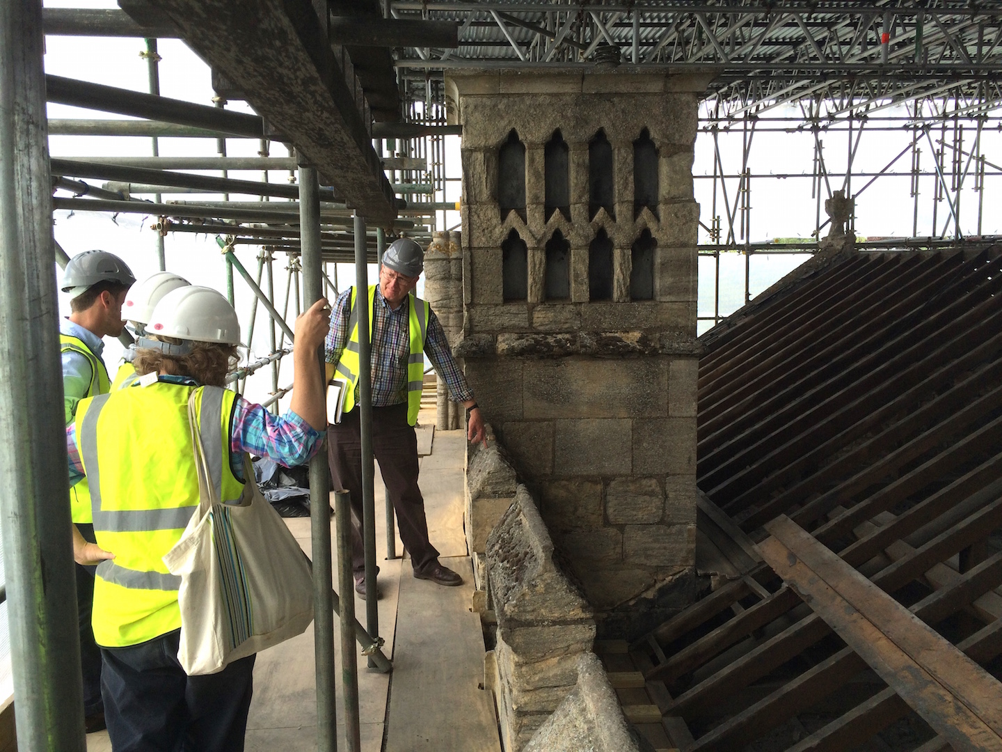 Tony Redman of WCP with Debbie Priddy (Historic England), Sam Falco (Peterborough City Council) and Dr Jackie Hall (Cathedral Archaeologist) on the roof of the Knights' Chamber. Credit: WCP