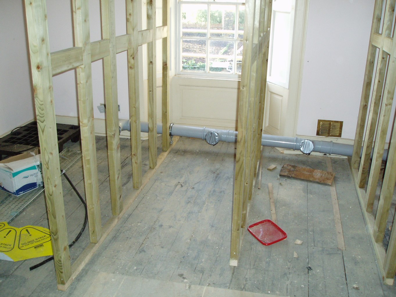 Studwork and first fix pipe work to the toilets