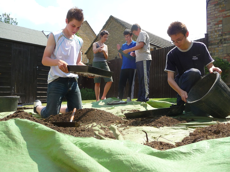 People sifting earth in a community archaeology project