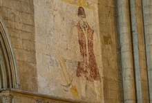 Wall painting of Robert or 'Old' Scarlett, a gravedigger of renown at the Cathedral in the 16th century. He buried Katherine of Aragon and Mary Queen of Scots and died at the ripe old age of 94.