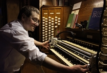 Ben Trenchard with the robot in the organ loft